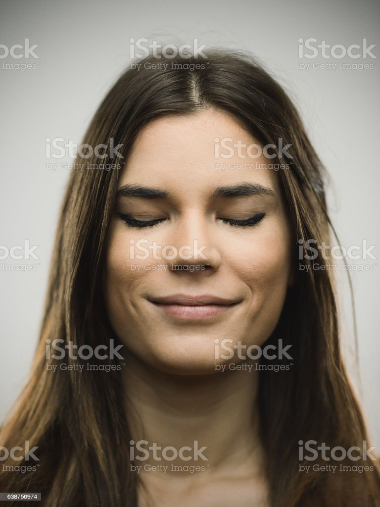 Excited woman smiling against gray background stock photo