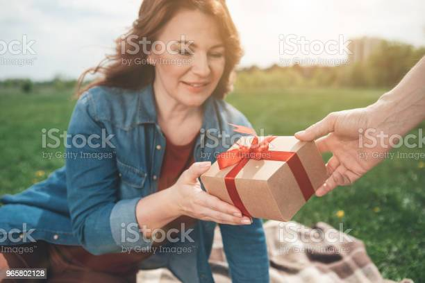 Excited Woman Taking Gift From Man Outdoor Stock Photo - Download Image Now