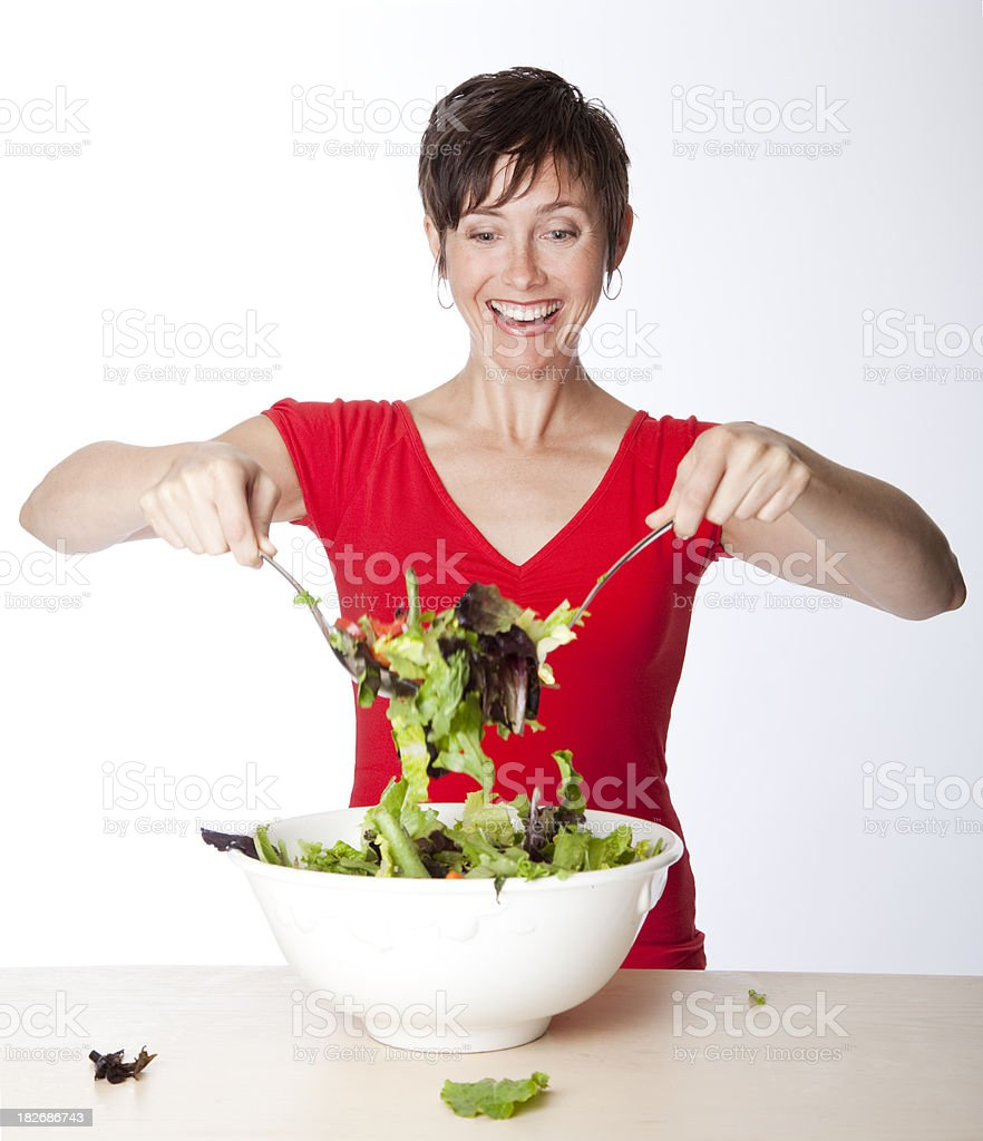 excited woman tossing salad royalty-free stock photo