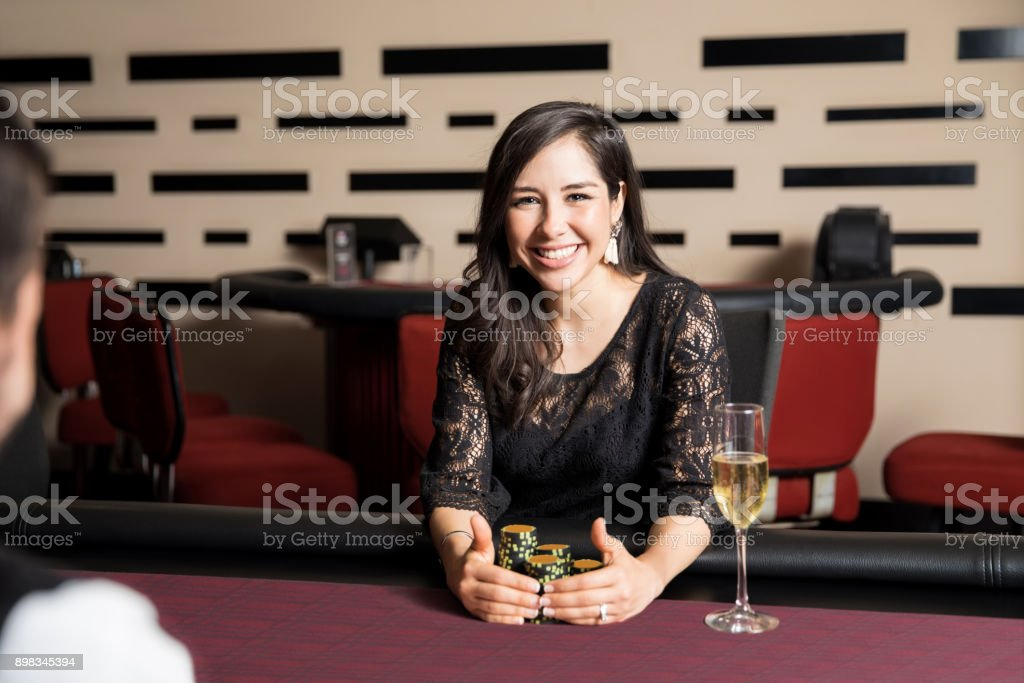 Excited woman winning in a casino stock photo