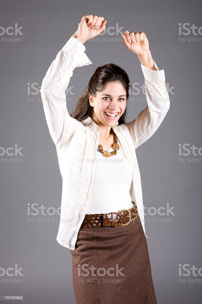 Excited Woman with Arms Raised royalty-free stock photo