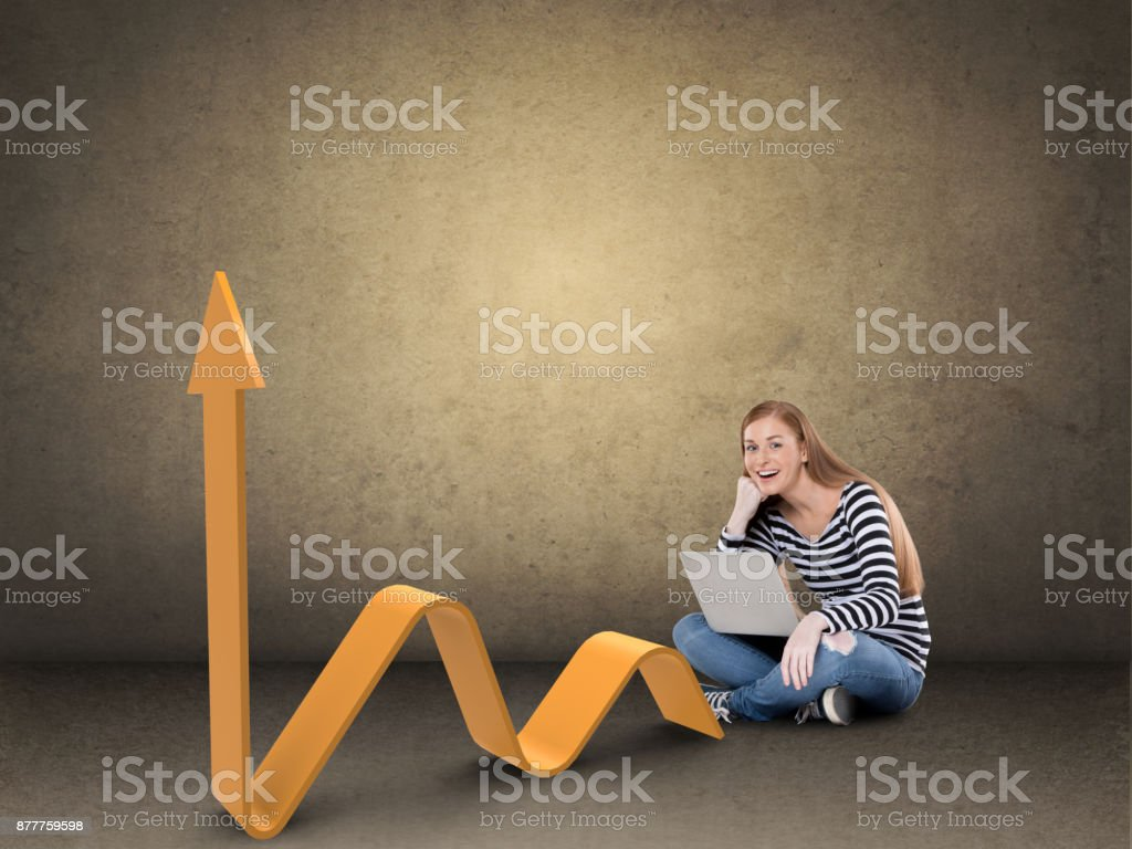 Excited woman with laptop and business graph stock photo