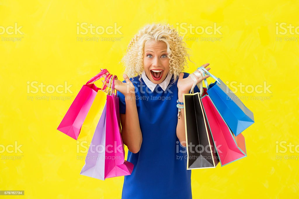 Excited woman with shopping bags stock photo