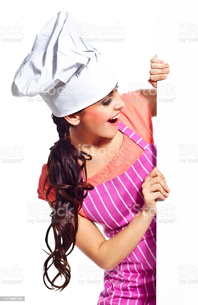 Excited woman with whiteboard Portrait of happy young woman wearing chef's hat and an apron, holding a whiteboard. Studio shot, isolated on white. 20-24 Years Stock Photo