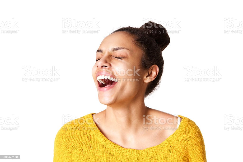 Excited young african woman laughing stock photo