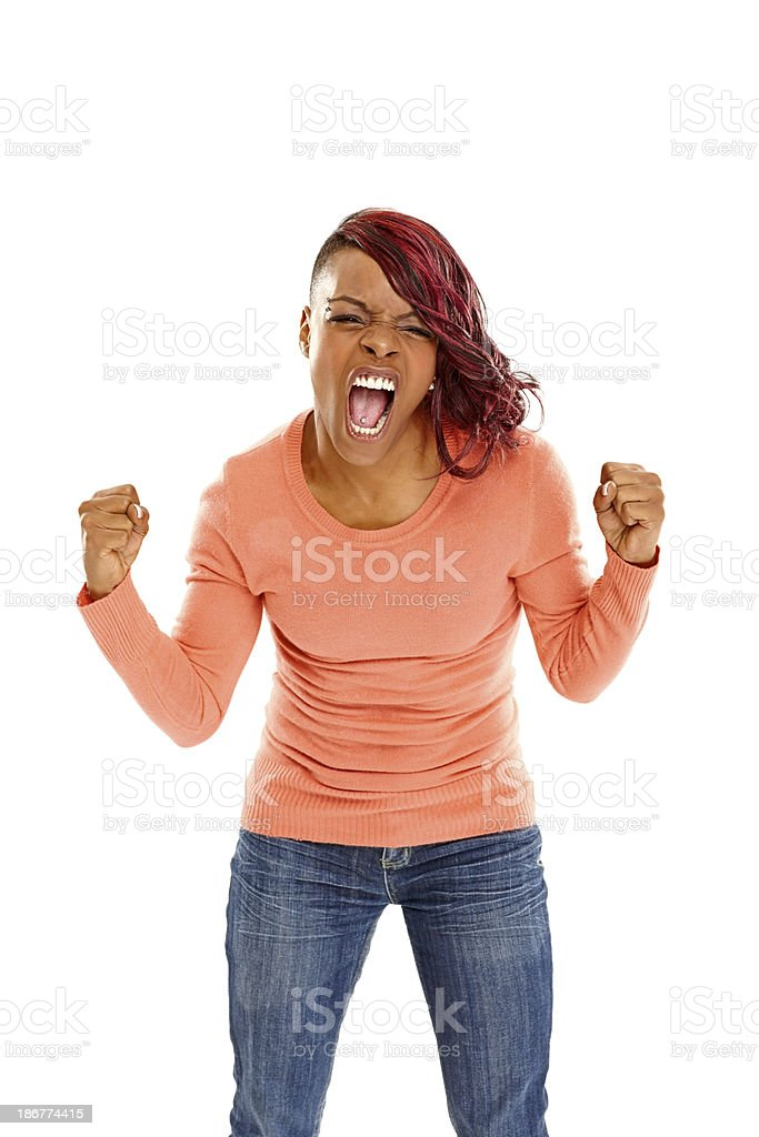Excited young african woman screaming stock photo