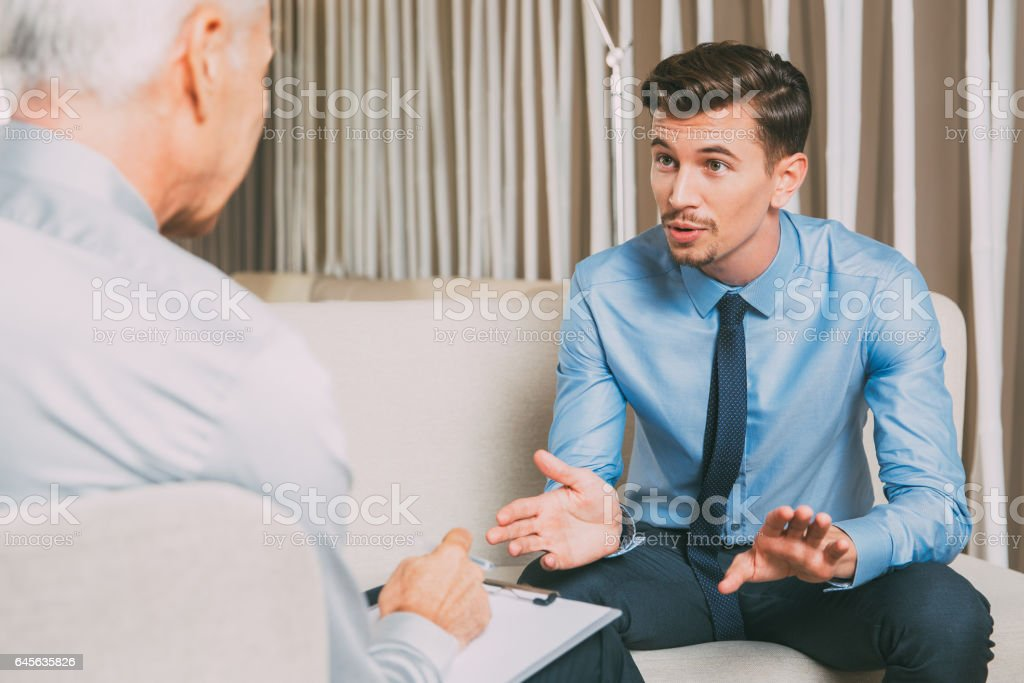 Excited Young and Senior Businessman Negotiating stock photo