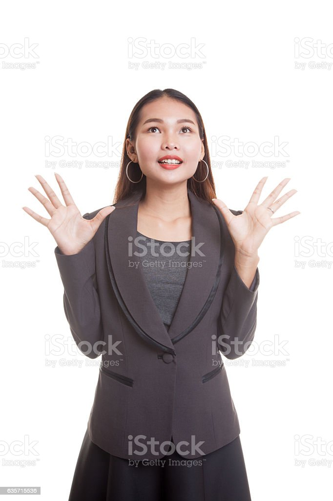 Excited young Asian business woman look up. royalty-free stock photo