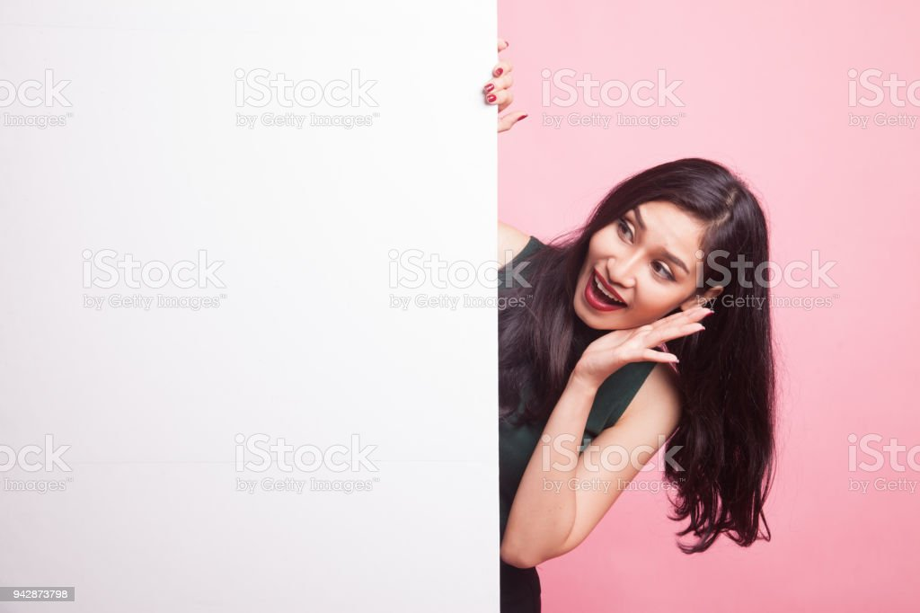 Excited young Asian woman with blank sign. stock photo