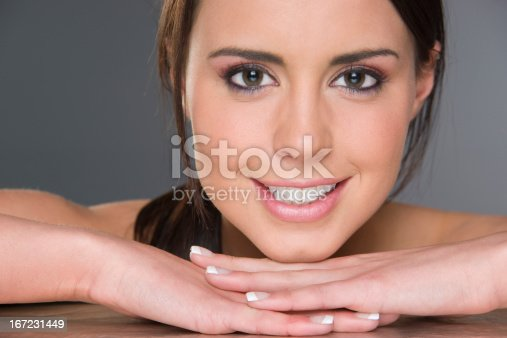 istock Excited Young Brunette Female Resting Head on Hands Headshot 167231449