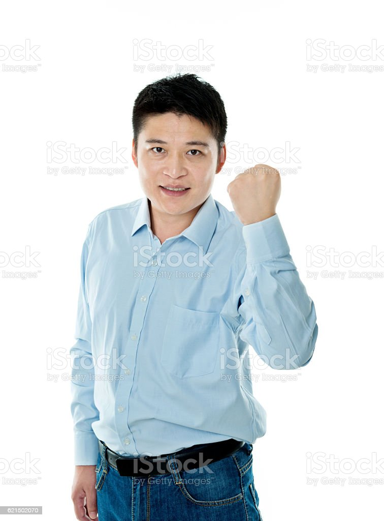 Excited young businessman cheering Lizenzfreies stock-foto