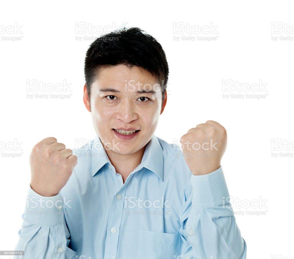 Excited young businessman cheering Lizenzfreies stock-foto