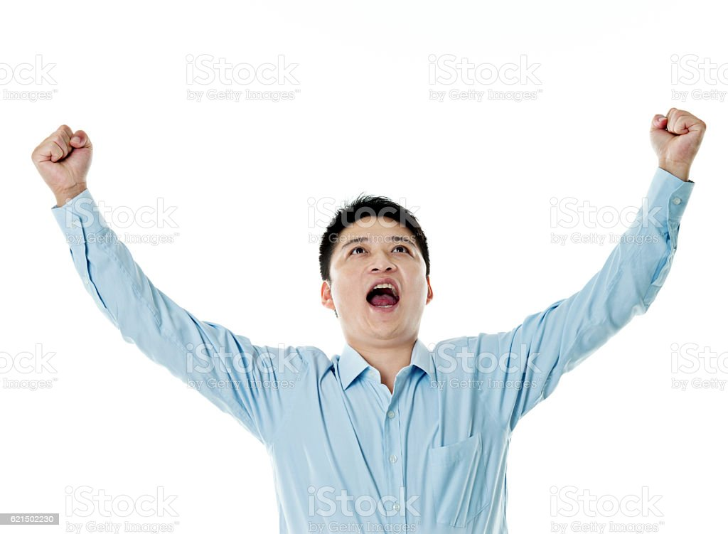 Excited young businessman cheering foto stock royalty-free