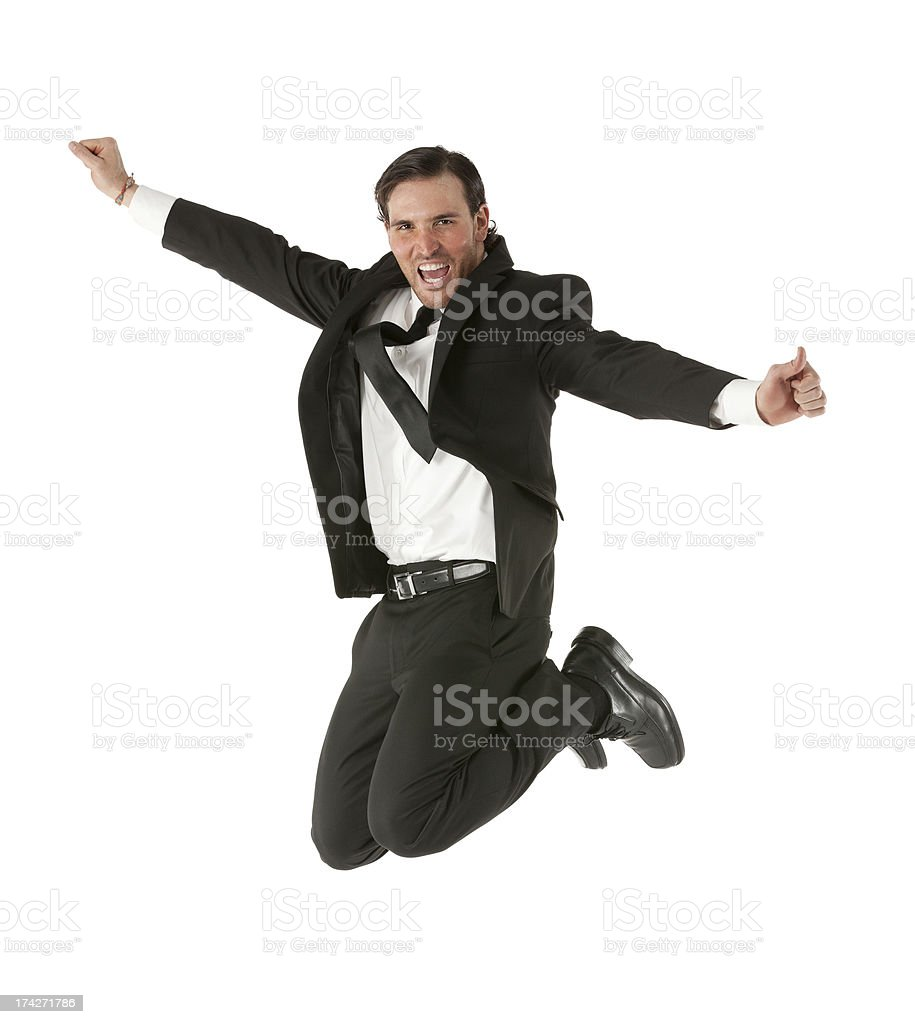 Excited young businessman jumping royalty-free stock photo