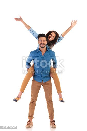 854381886 istock photo excited young casual couple 854378800