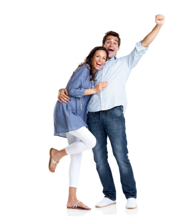istock Excited young couple celebrating victory with hands raised 121351491