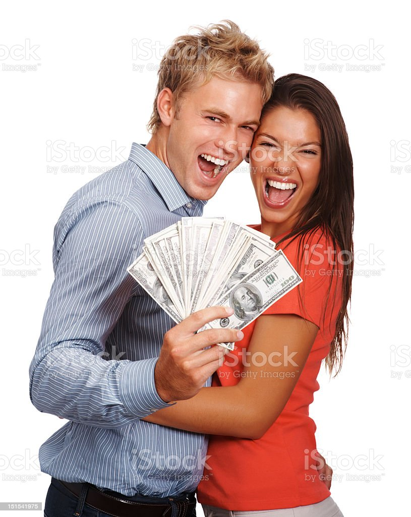 Excited young couple holding cash royalty-free stock photo