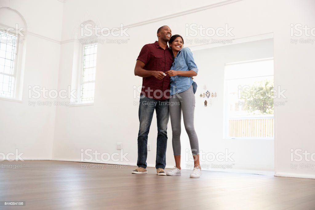 Excited Young Couple Moving Into New Home Together stock photo