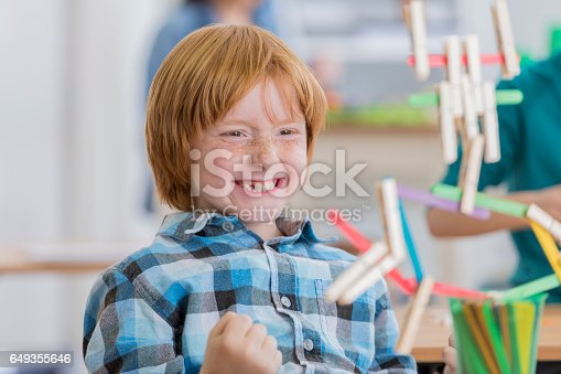 648947070 istock photo Excited young creative student enjoys building in class 649355646
