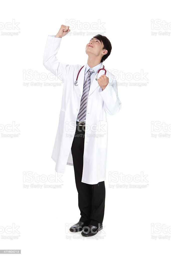 Excited young doctor rise his arm royalty-free stock photo