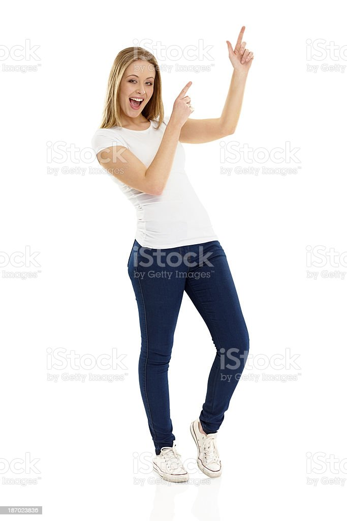 Excited young girl pointing at empty space on white royalty-free stock photo