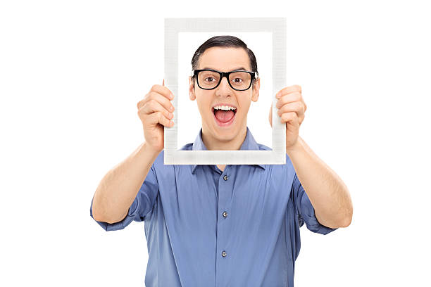 Royalty Free Man Holding Frame Pictures, Images and Stock Photos ...