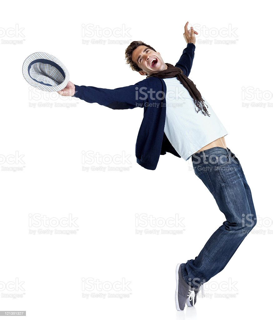 Excited young man dancing royalty-free stock photo