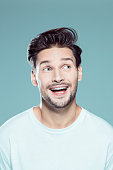 istock Excited young man looking away 1131320356