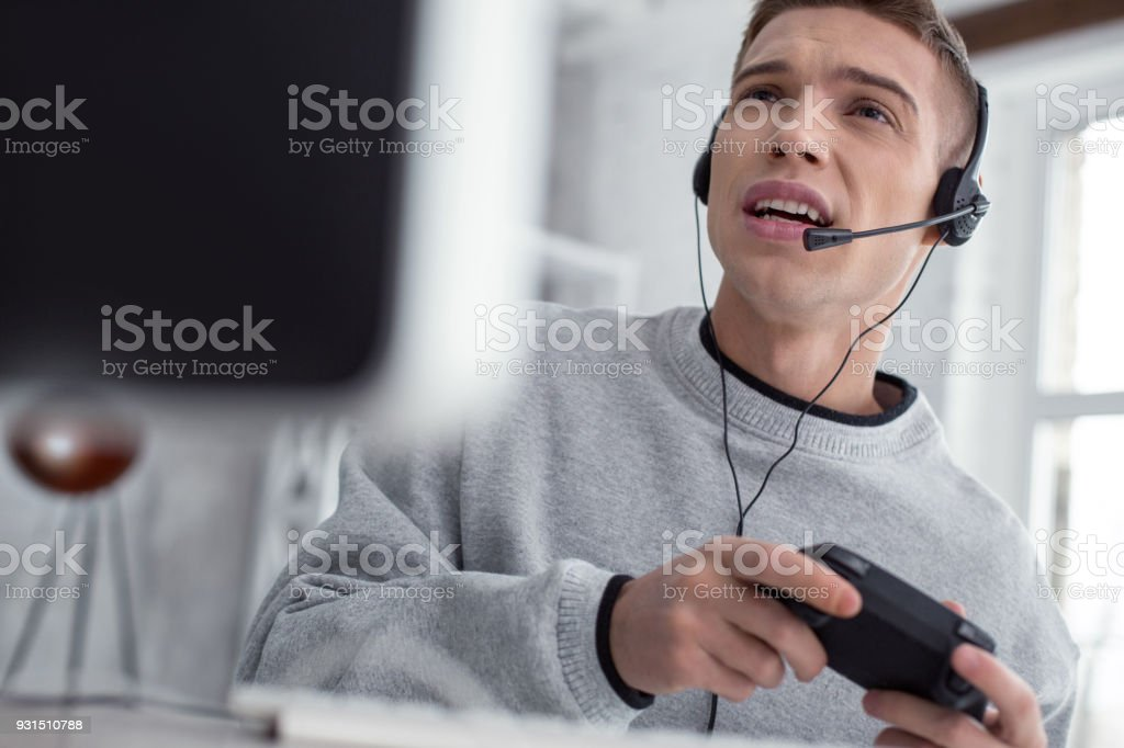 Excited young man playing computer games stock photo