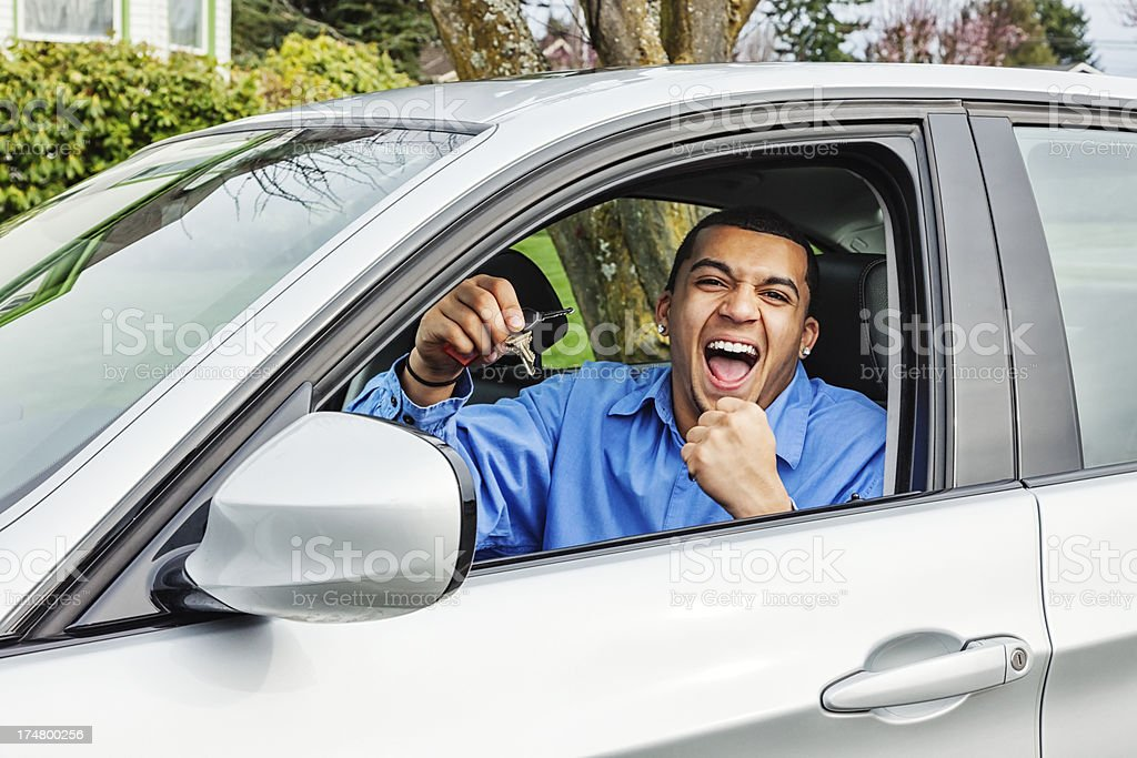 Excited Young Man with New Car stock photo