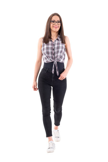 Excited young millennial modern hipster style girl walking smiling and looking away. Excited young millennial modern hipster style girl walking smiling and looking away. Full body isolated on white background. approaching stock pictures, royalty-free photos & images