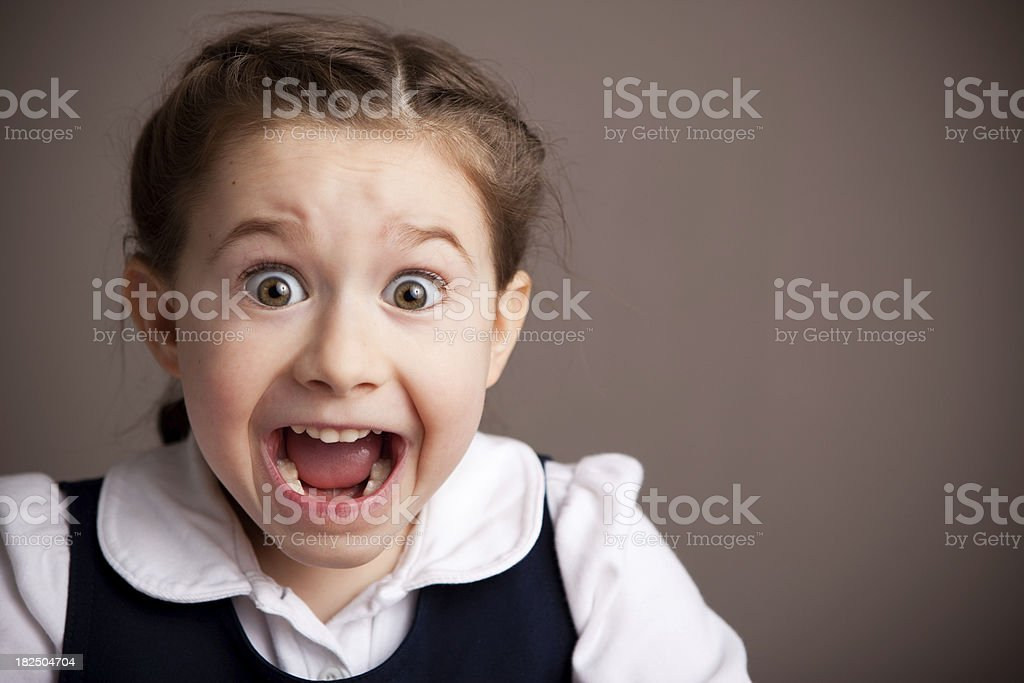 Excited Young Student Girl in School Uniform stock photo