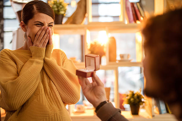 Excited young woman getting engaged. stock photo