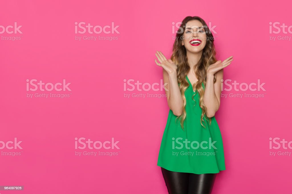 Excited Young Woman In Green Top Is Gesturing And Shouting - Royalty-free Adult Stock Photo