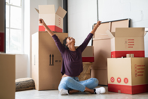 istock Excited young woman in new house 1158245622