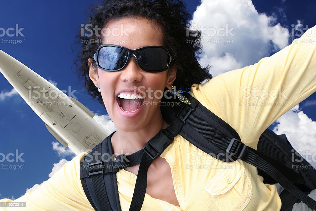 Excited young woman jumping out of a plane royalty-free stock photo