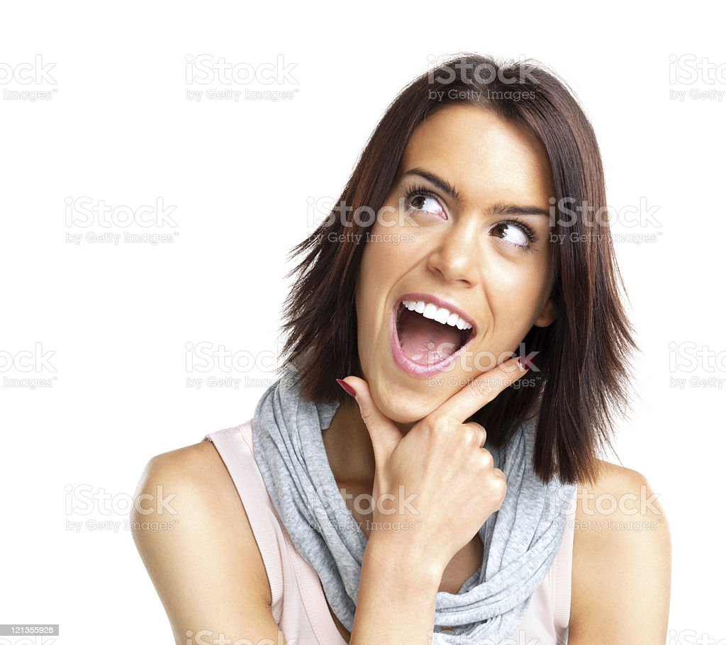 Excited, young woman looking surprised against white background royalty-free stock photo