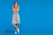istock Excited Young Woman On Blue Background 861535648