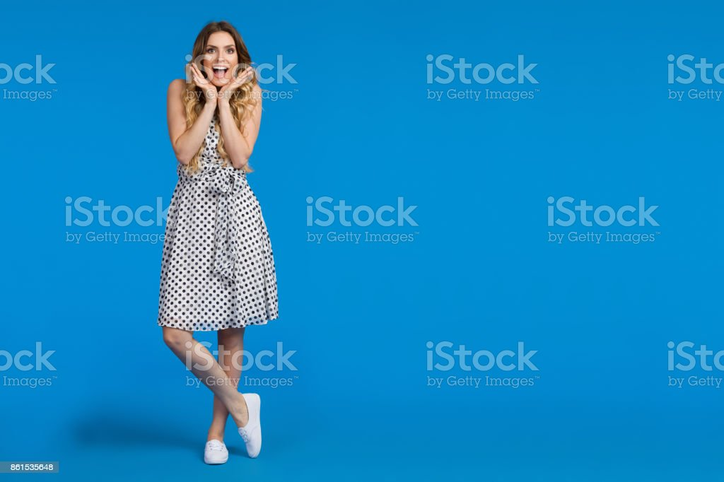 Excited Young Woman On Blue Background stock photo
