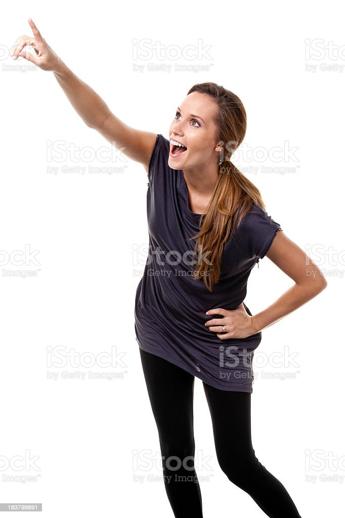 Excited Young Woman Pointing Upwards royalty-free stock photo