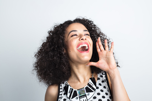 Excited Young Woman Shouting Stock Photo - Download Image Now