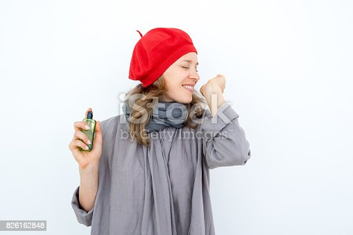 istock Excited young woman testing new perfume 826162848