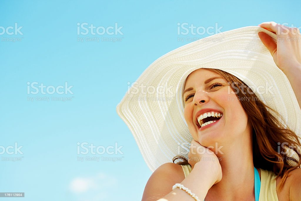 Excited young woman wearing a sun hat stock photo