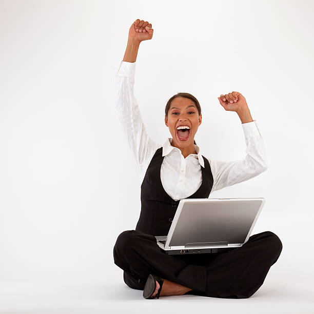Excited Young Woman With Laptop stock photo