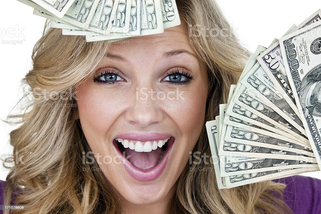 Excited young woman with lots of cash royalty-free stock photo