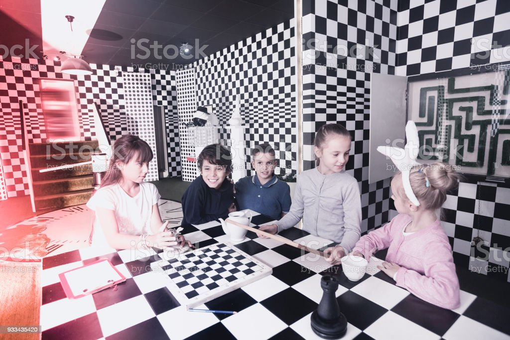 Exciting adventure for kids in chess quest room stock photo
