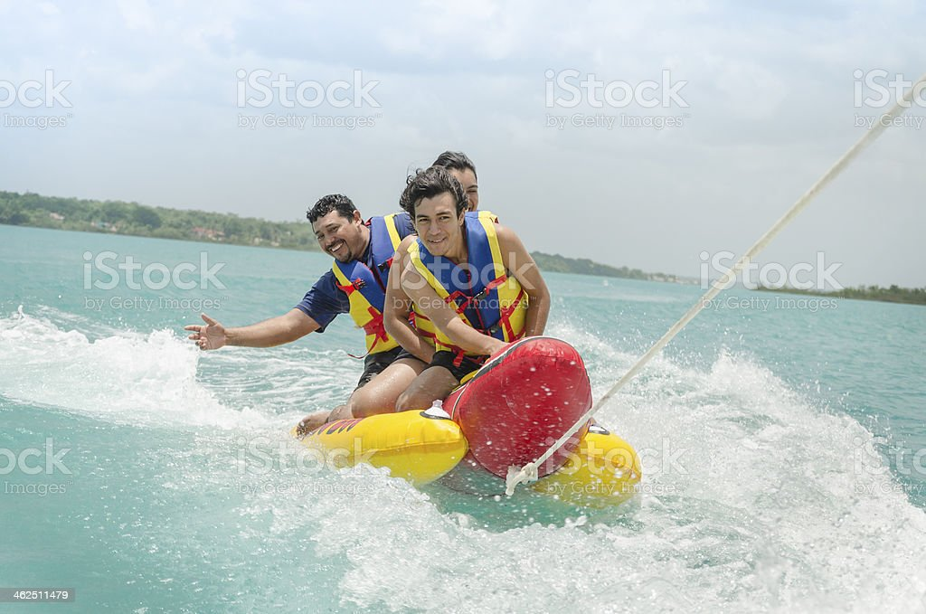 Exciting banana surf ride stock photo