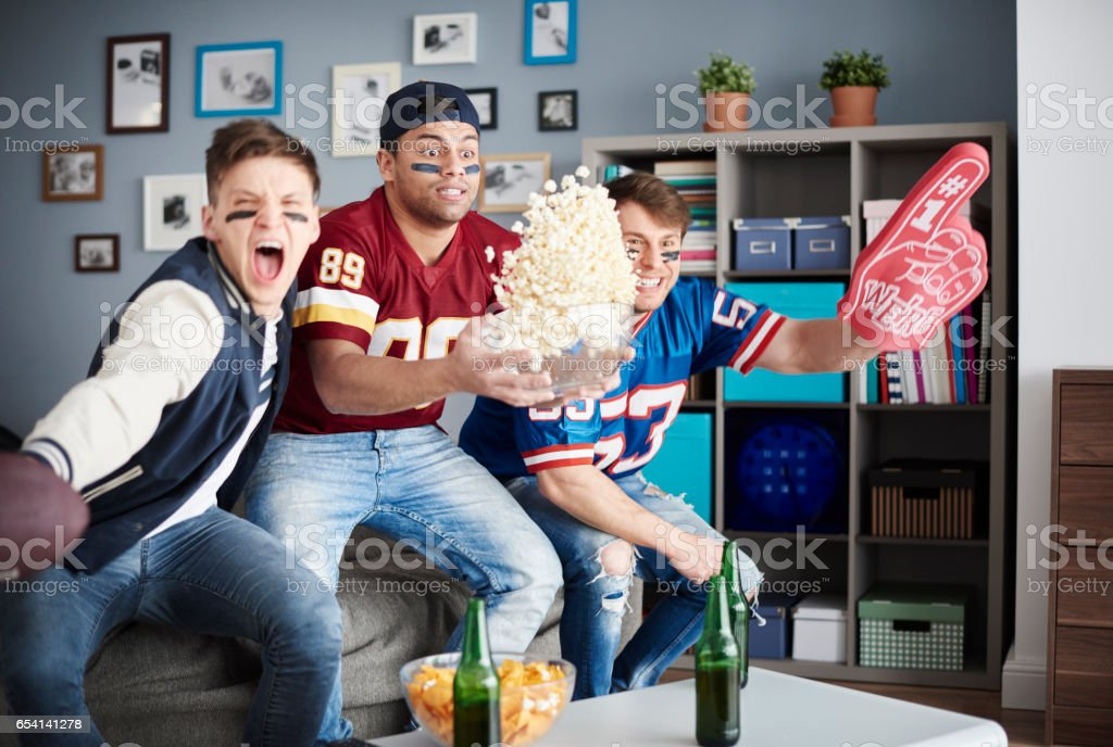 Exciting scene of American football supporters stock photo