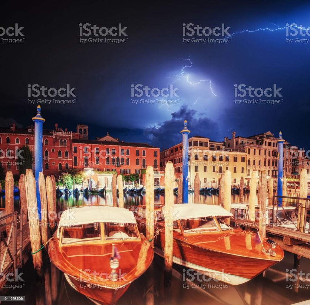 Exciting sky with lightning. The water from boats stock photo