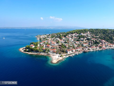 istock Exciting sunny warm day townscape of fisher man village and island Solta south of Split. Famous destination for tourists in Adriatic sea and the central Dalmatian archipelago, Croatia, Europe. 1137032600